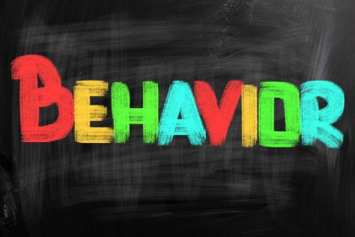 Behavior Concept - The words behavior on a chalkboard background