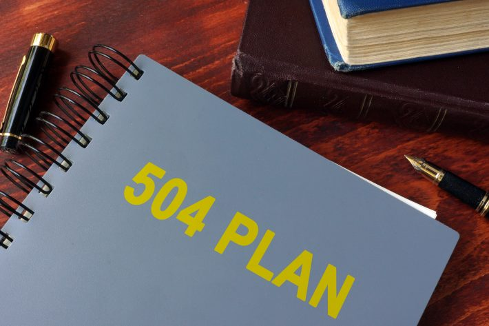Book with title 504 plan. Special education concept.
