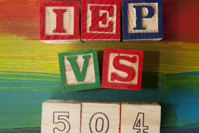 504 Plan VS. IEP (Individualized Education Plan) alphabet blocks