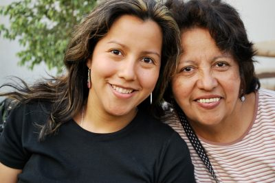 Hispanic mother and her grown daughter