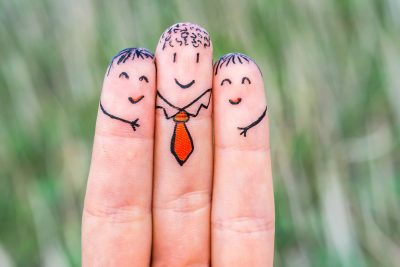 Three fingers depict a family with drawn faces of mom, dad and child