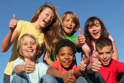 diverse grop of kids, children or tweens thumbs up