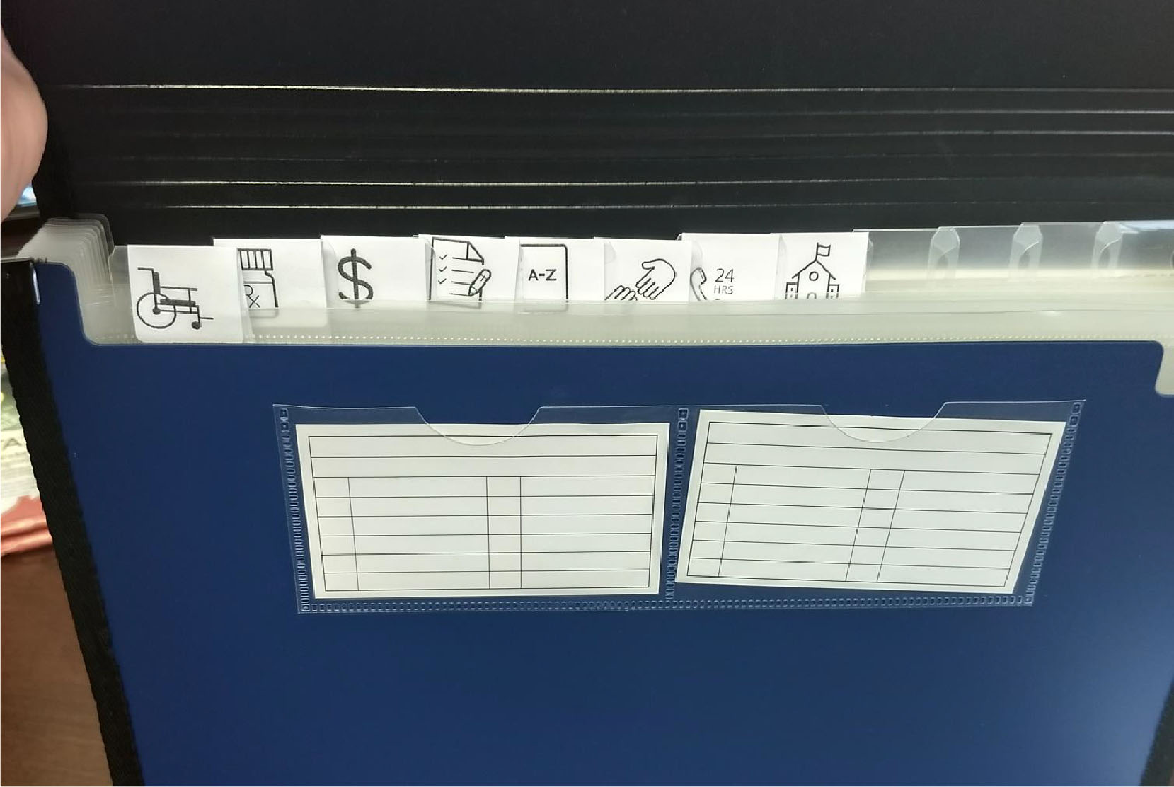 An accordion container is organized with tabs to keep documents in order