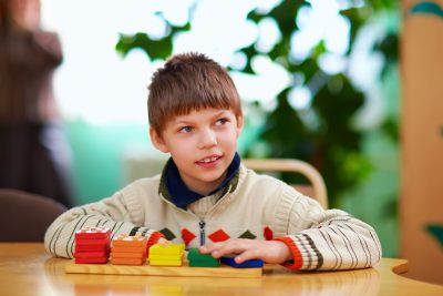 A boy is playing with wooden blocks