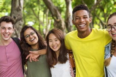 A group of Teenagers are posing and smiling