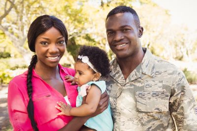 Military Family poses with their Baby