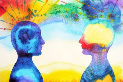 A watercolor of two heads looking at each other, showing their differently colored brains