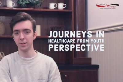 Young man poses at an office with the words Journeys in Healthcare