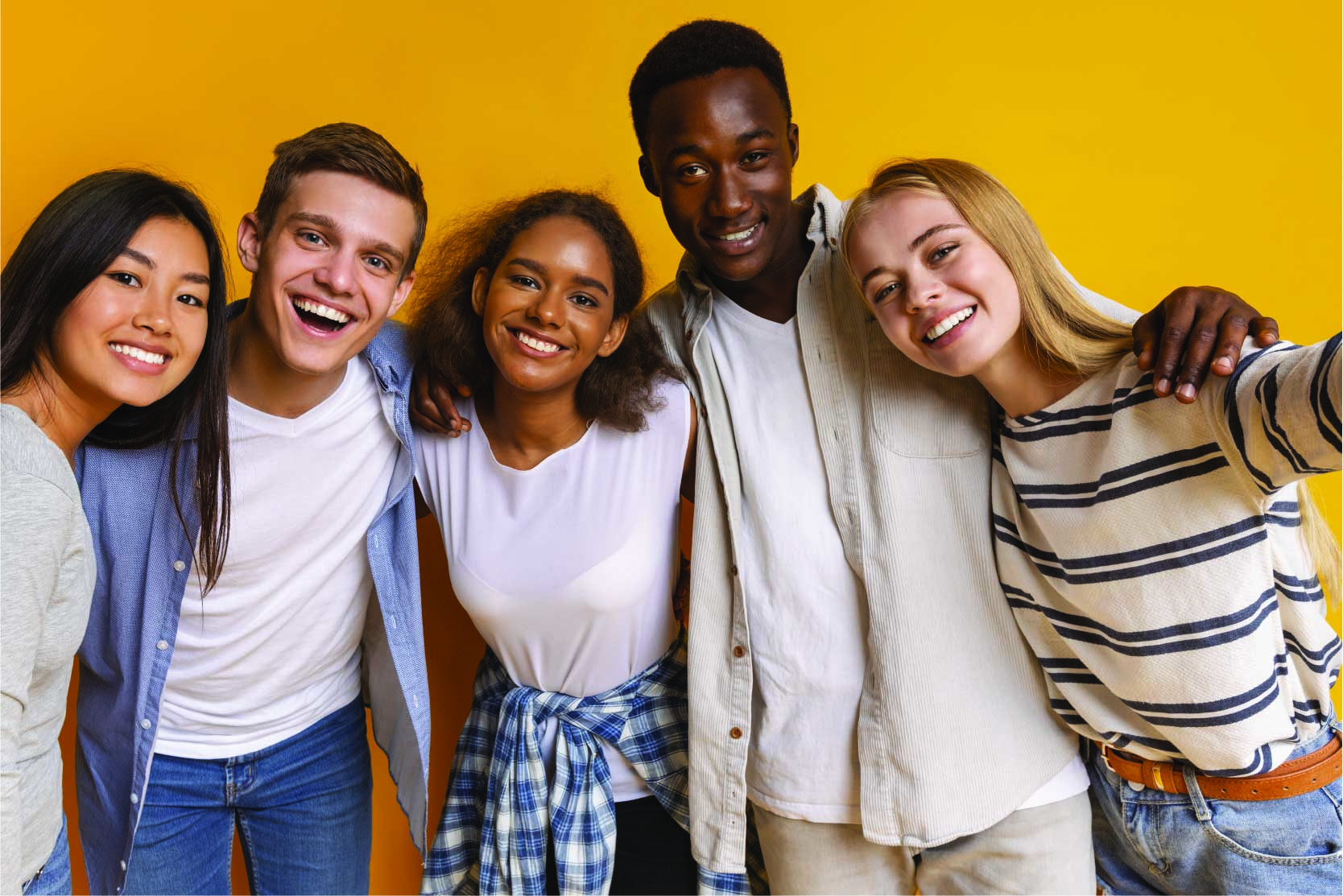 Diverse teens pose and smile against a yellow background