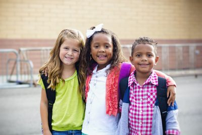 Diverse group of young kids going to school